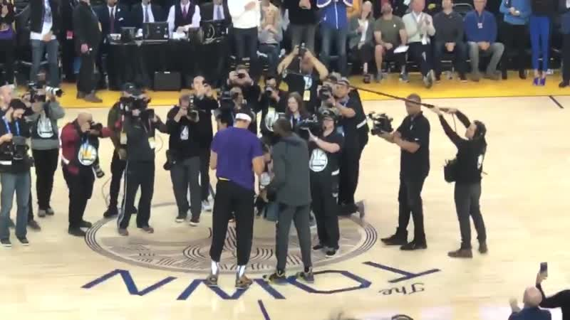 Andre Iguodala presents JaVale McGee his 2018 championship ring