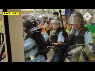 Hong kong policeman draws pistol on protesters after being beaten with own baton