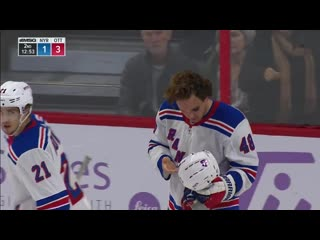 Brendan lemieux picks tooth up off the ice after high stick from christian jaros
