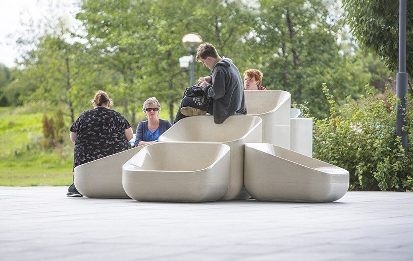 raw edges installs a relaxing cluster of concrete seats facing london's NOW gallery