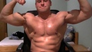 Young Bodybuilder 51 cm biceps pumping pose on webcam