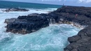 Kid swimming to survive scary wave Queen's Bath Kauai, Hawaii