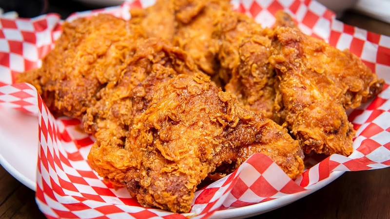 Don Chon in Toronto pours soy sauce glaze over its fried chicken