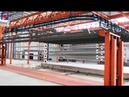 Power and free overhead conveyor system for long Street light pole